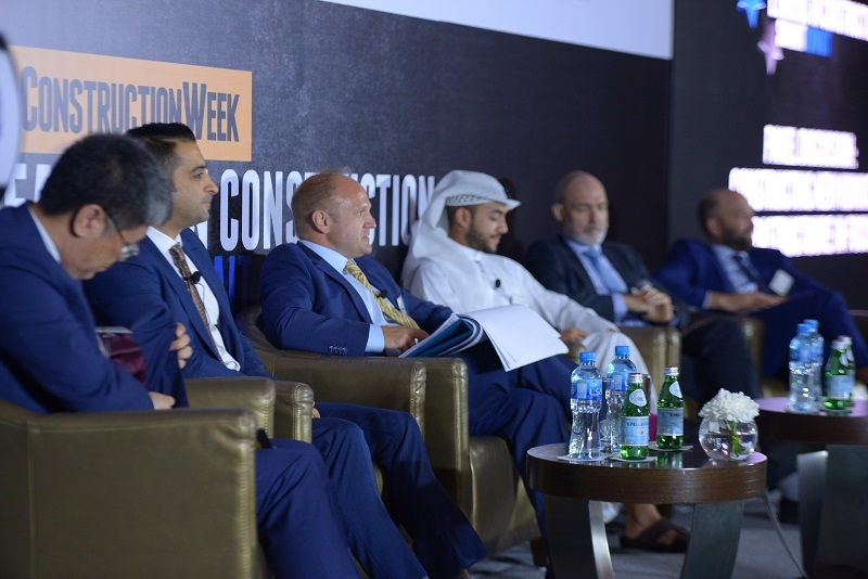 Charles Lilley, partner at law firm BCLP [centre], chaired the first panel at Leaders in Construction Kuwait 2018 summit.
