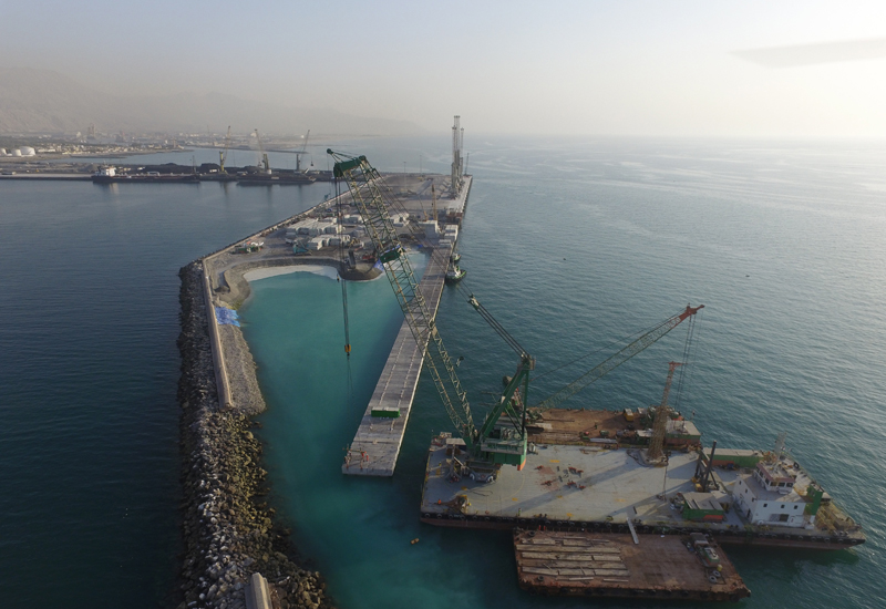 Block placing work under way using a crane barge at Saqr Port in the UAE's Northern Emirate of Ras Al Khaimah [image: Bam International].