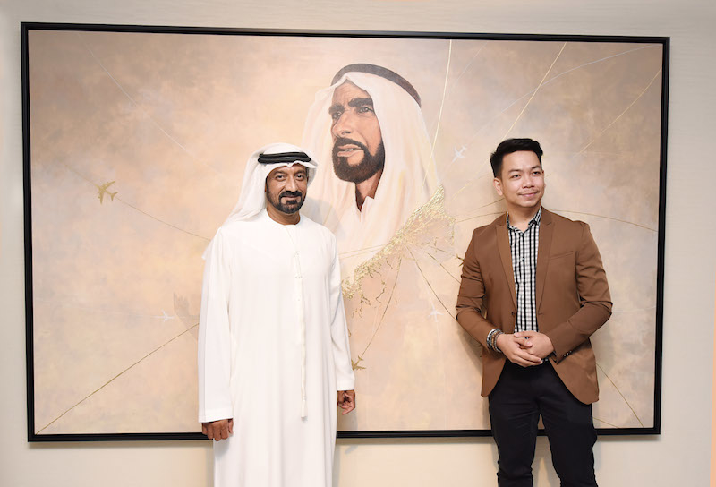 HH Sheikh Ahmed bin Saeed Al Maktoum with Elygraf, the Filipino artist that worked on the artwork now installed at Emirates' headquarters office in Dubai.