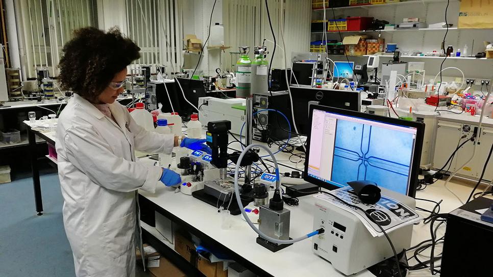 Dr Livia Ribeiro De Souza using a Dolomite Microfluidics system to produce 'self-healing' building materials.