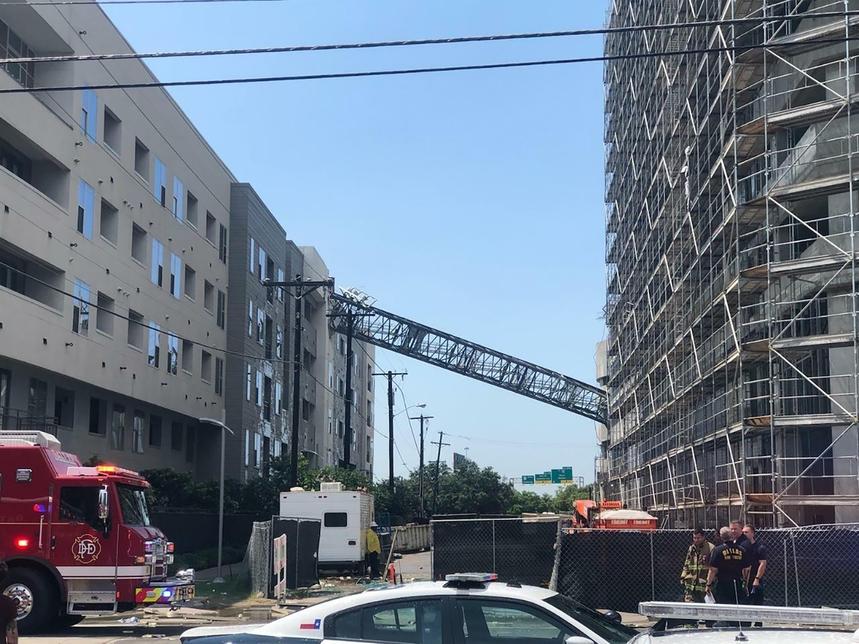 A construction crane collapsed in Dallas.