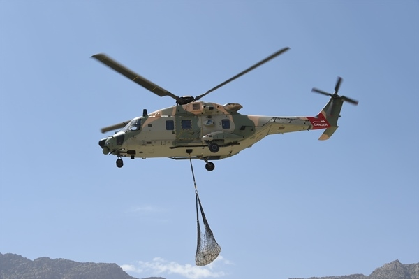 Construction materials were air-lifted to remote areas of Oman.