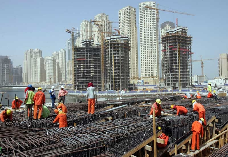 Work permits and residence visas will be issued and renewed automatically for labourers [representational]