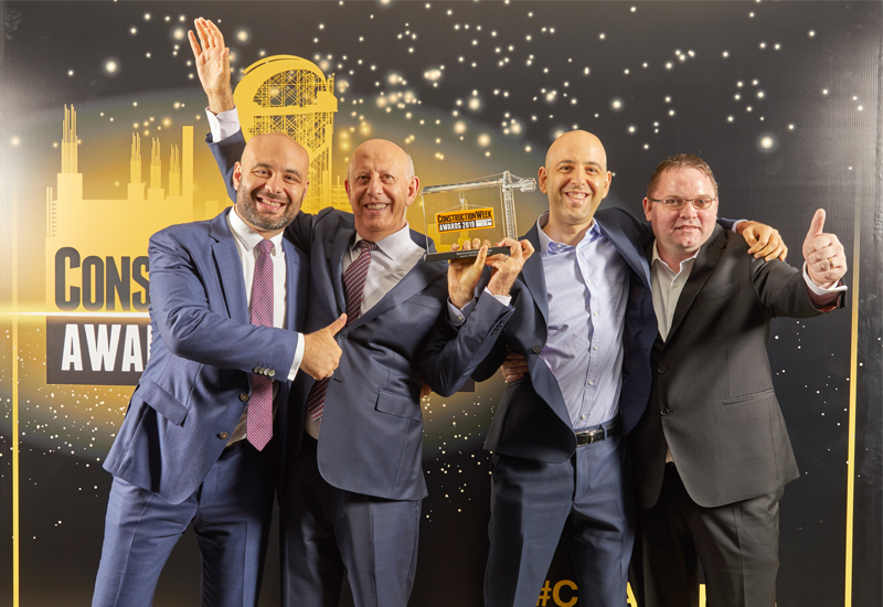 The JLW Middle East team picking up the Sub-Contractor of the Year award