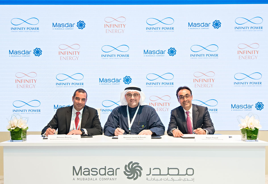 The agreement being made between Masdar  and Infinity Energy [Image: Supplied]