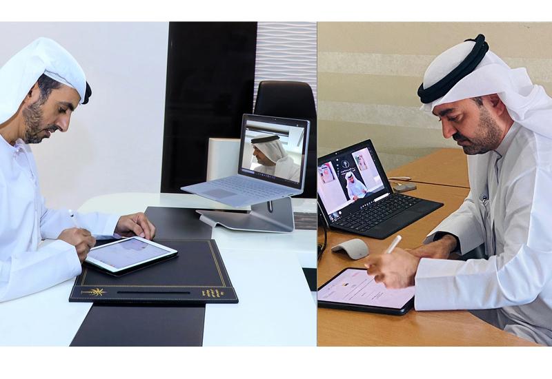 DLD's HE Juma bin Humaidan (left) and Amlak Finance's Arif Alharmi Albastaki signing the agreement