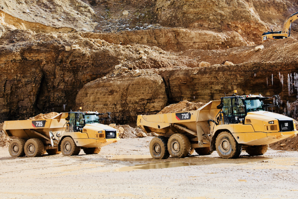 Three new Cat articulated trucks extensively redesigned