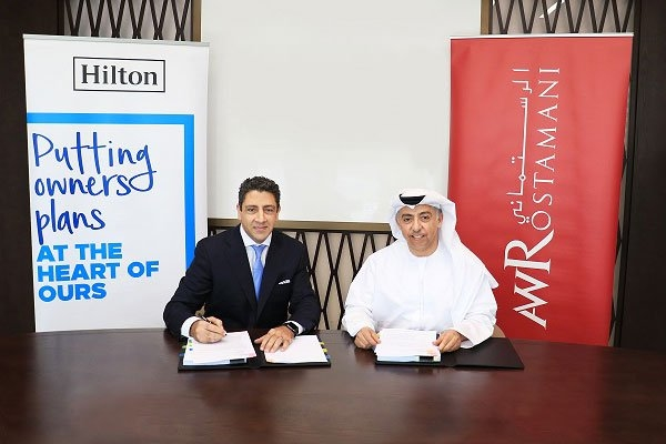 Carlos Khneisser, Hilton's vice president of development, Middle East & North Africa, Hilton and Khalid Abdul Wahid Al Rostamani, chairman of AW Rostamani Group.
